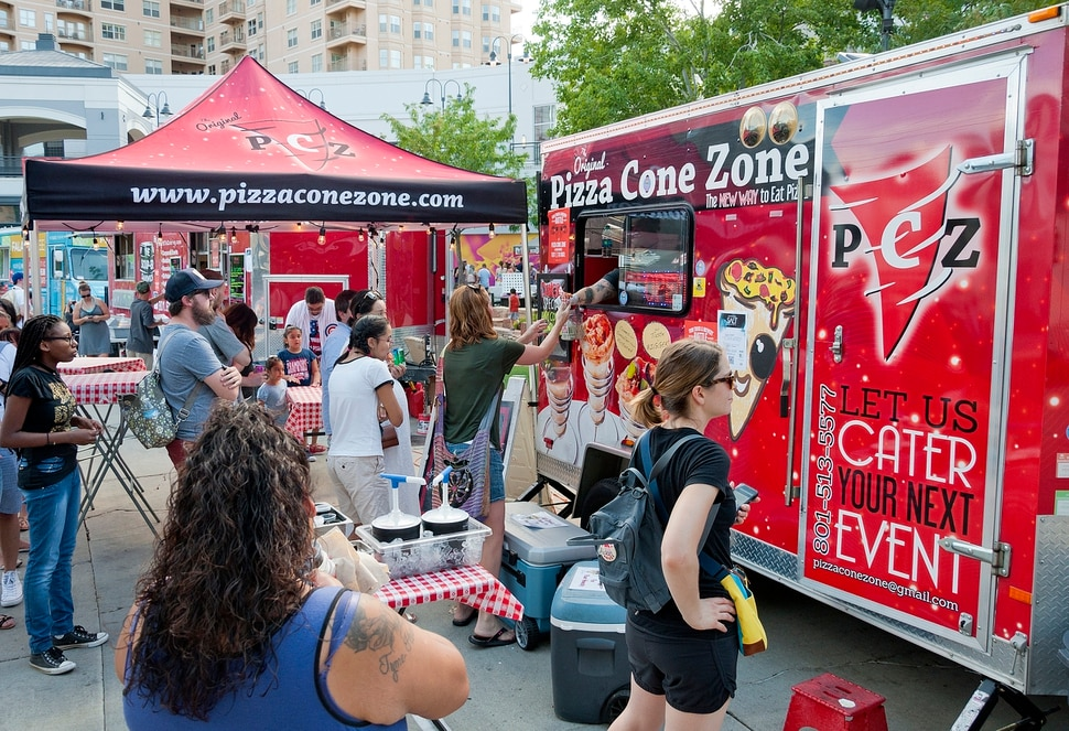 (Michael Mangum | Special to the Tribune) Patrons line up at the Pizza Cone Zone truck during the Food Truck & Brewery Battle at The Gateway in Salt Lake City, Utah, on Saturday, August 12, 2017.