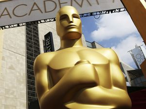 (Matt Sayles  |  AP file photo) A giant replica of an Oscar statuette outside the Dolby Theatre in Los Angeles. The 93rd Academy Awards will happen Sunday, April 25, from the Dolby Theatre and Union Station in Los Angeles — thus allowing a socially distanced group of nominees and presenters on Hollywood's biggest night, in spite of the COVID-19 pandemic.