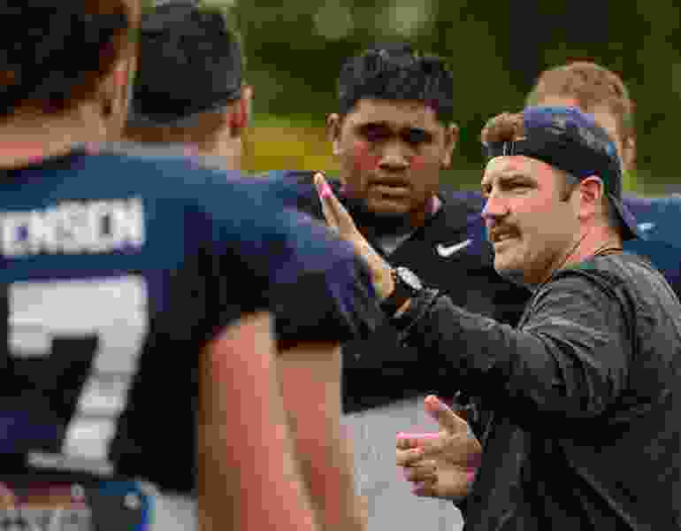 New BYU offensive line coach combines seriousness with a dry wit to keep players striving for improvement