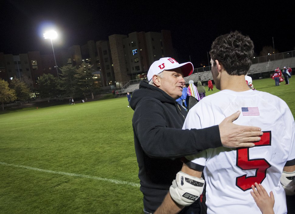 (Michael Mangum | Special to the Tribune) Utah Utes men's lacrosse team donor David Neeleman hugs his son, freshman defender Seth Neeleman (5), after the team's loss to the Texas Longhorns at Ute Soccer Field in Salt Lake City, April 13, 2017.