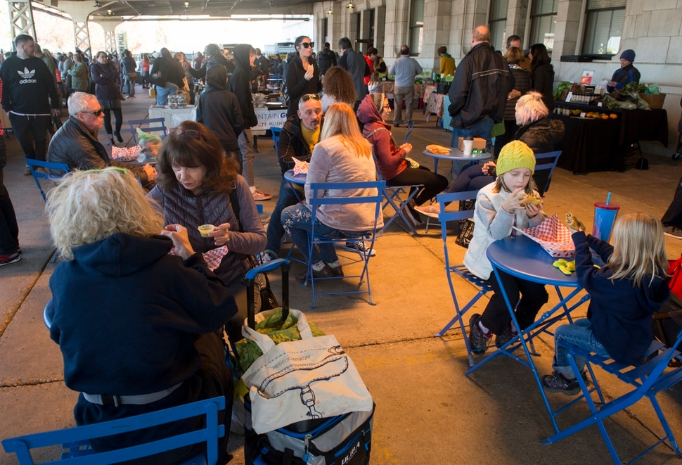 (Rick Egan | The Salt Lake Tribune) Shoppers enjoy their food at the Downtown Winter Market which opened today at the Rio Grande Depot, Saturday, Nov. 10, 2018.