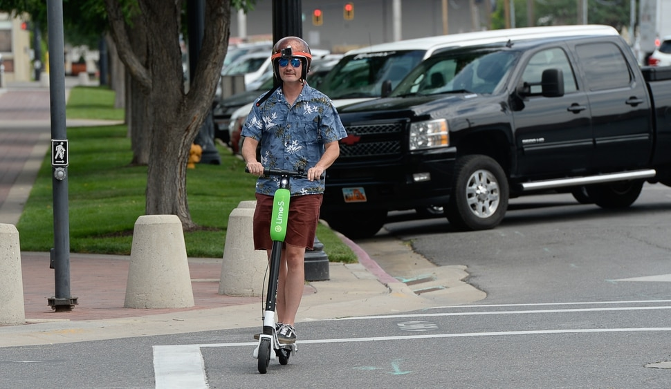 (Francisco Kjolseth | The Salt Lake Tribune) Salt Lake Tribune columnist Robert Gehrke finishes his race against colleagues during a downtown transportation race from Library Square to the Tribune building at the Gateway on Thursday, Aug. 2, 2018. Modes of transportation included, rentable electric scooters, Green Bike, TRAX, Lyft, and walking.