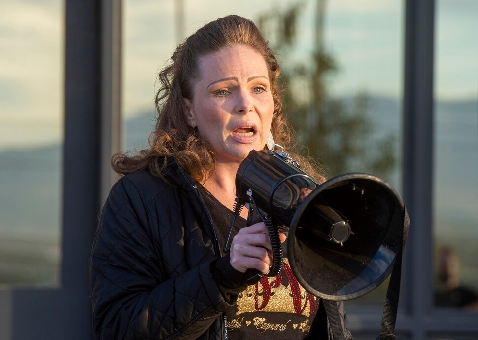 (Rick Egan | The Salt Lake Tribune) Beth Thompson speaks at a rally for prison inmates, after a COVID-19 outbreak has spread at the Draper prison, at the Department of Corrections, on Tuesday, Oct. 13, 2020.