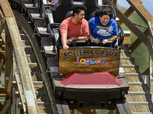 (Leah Hogsten     The Salt Lake Tribune) Lagoon Amusement Park visitors ride The Roller Coaster, Monday, June 15, 2020.