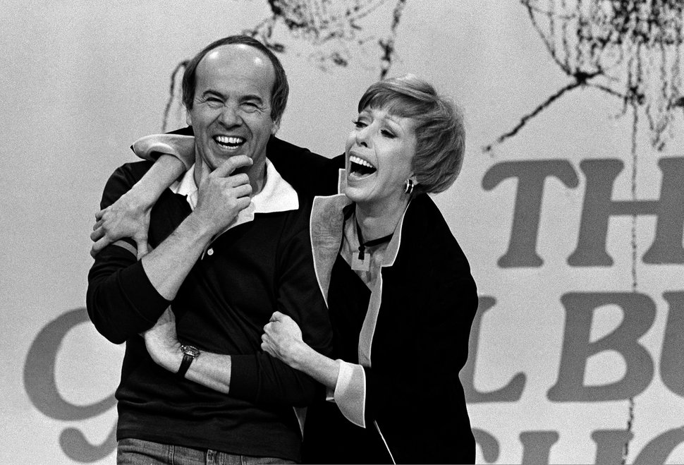 FILE - In this March 19, 1978 file photo, Carol Burnett, right, laughs with Tim Conway during taping of her final show, in Los Angeles. Conway, the stellar second banana to Burnett who won four Emmy Awards on her TV variety show, died Tuesday, May 14, 2019, according to his publicist. He was 85. (AP Photo/ George Brich, File)