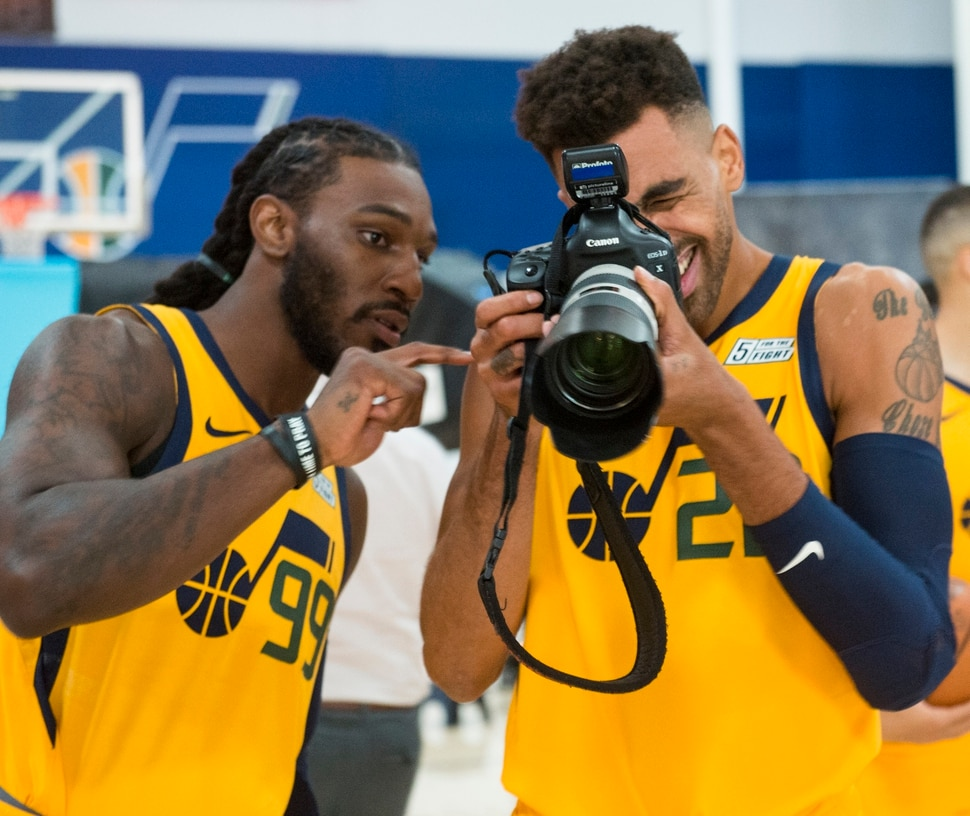 (Rick Egan | The Salt Lake Tribune) Jazz players Jae Crowder and Thabo Sefolosha mess around with a camera during the Utah Jazz annual Media Day photo shoot, Monday, Sept. 24, 2018.