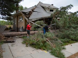 (Francisco Kjolseth     The Salt Lake Tribune) Erick Dowling, left, and Brian Nichols help chop up a tree that fell on April Hogue's house in the Avenues in Salt Lake City following hurricane-force winds on Tuesday, Sept. 8, 2020.