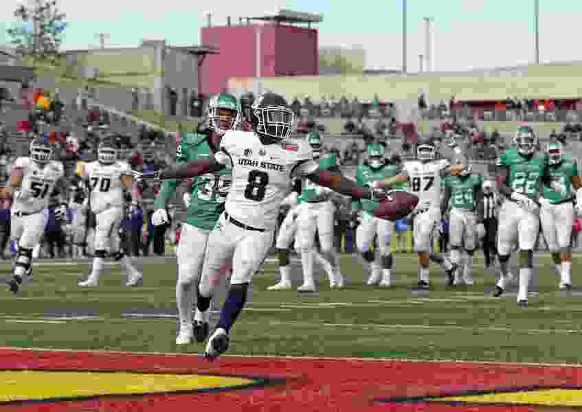 Aggie running backs Gerold Bright and Darwin Thompson find plenty of daylight against Mean Green defense in New Mexico Bowl victory