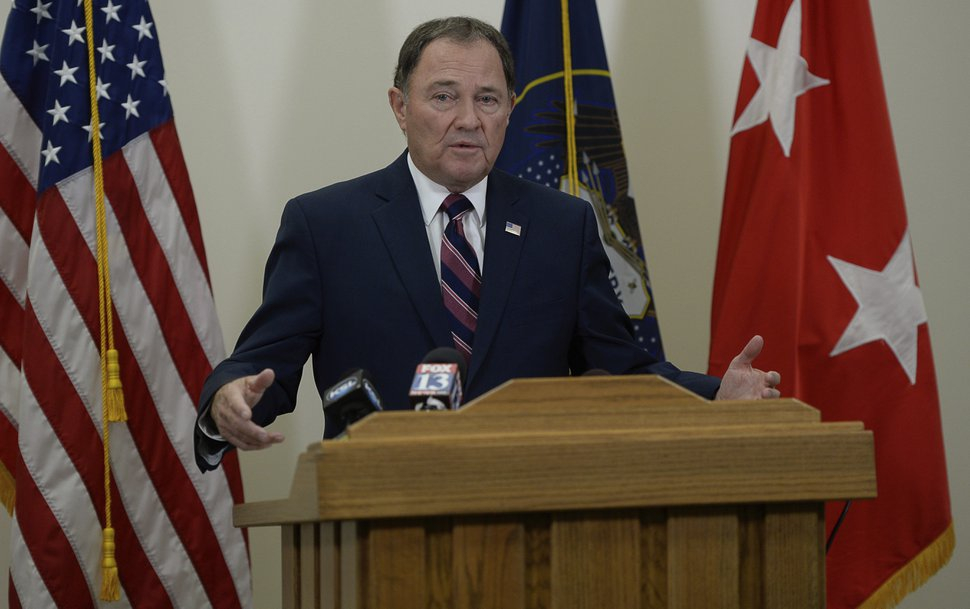 Gov. Gary Herbert addresses the media on Sunday, Nov. 4, 2018, in Draper, Utah. Military officials say a major in Utah's Army National Guard who was also the mayor of a city north of Salt Lake City was killed in Afghanistan after being shot by a member of the Afghan security forces. They say North Ogden Mayor Brent Taylor was in the country to train Afghan commandos and was shot Saturday, Nov. 3, 2018, by one of the trainees at the Kabul military training center. The attacker was then killed by Afghan forces. (Francisco Kjolseth/The Salt Lake Tribune, via AP)
