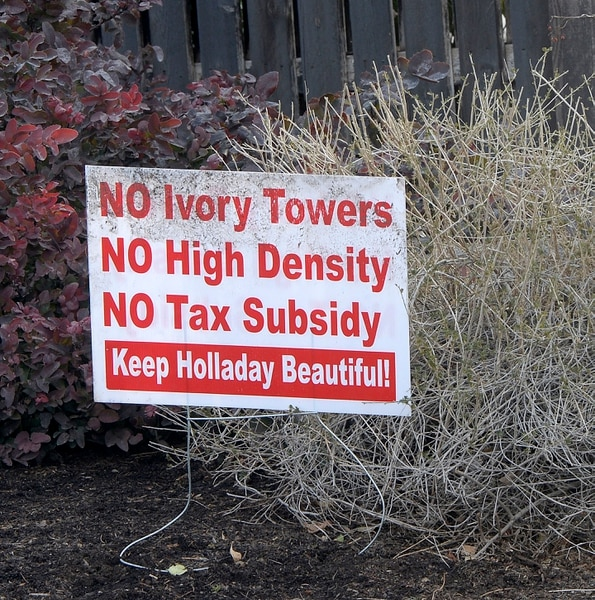 (Al Hartmann | The Salt Lake Tribune) Signs in the front yards of homeowners in the area of the old Cottonwood Mall site near 4800 S. Highland Drive in Holladay on Tuesday March 13, 2018.