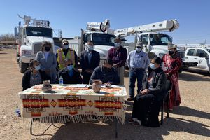 (Courtesy of the Navajo Nation Office of the President and Vice President) Navajo Tribal Utility Authority officials and Miss Navajo Nation Shaandiin Parrish look on as Navajo Nation President Jonathan Nez signs the lease agreement for the Red Mesa Tapaha Solar Generation Plant in Red Mesa, Ariz., on April 7, 2020. He was joined by Council Delegate Charlaine Tso (bottom, right) and Red Mesa Chapter officials, including Red Mesa Chapter Vice President Marilyn Holly (bottom, left) and President Herman Farley (bottom, second from left).