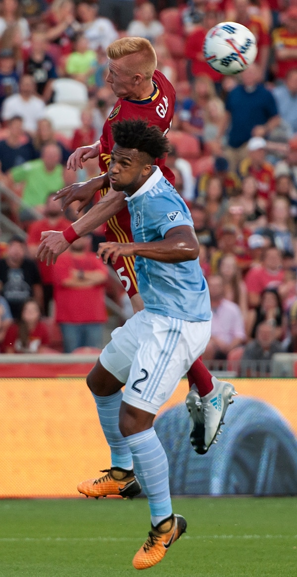 Michael Mangum | Special to the Tribune Sporting Kansas City defender Erik Palmer-Brown (2) and Real Salt Lake defender Justen Glad (15) battle in the air for a header during their match at Rio Tinto Stadium in Sandy, UT on Saturday, July 22, 2017.