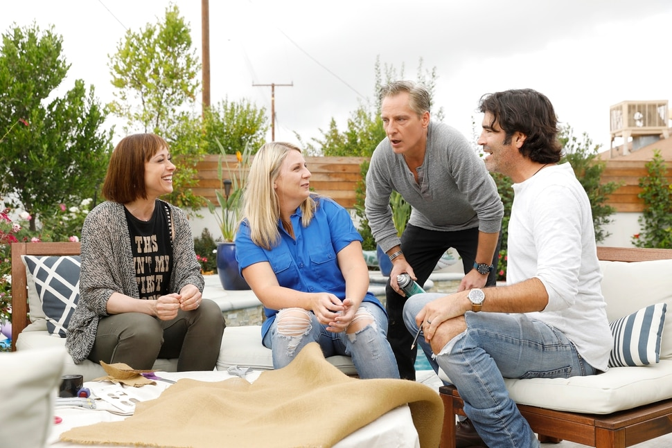 """(Photo courtesy Trae Patton/TLC) Host Paige Davis, a homeowner, designer Doug Wilson and carpenter Carter Oosterhaus in """"Trading Spaces."""""""