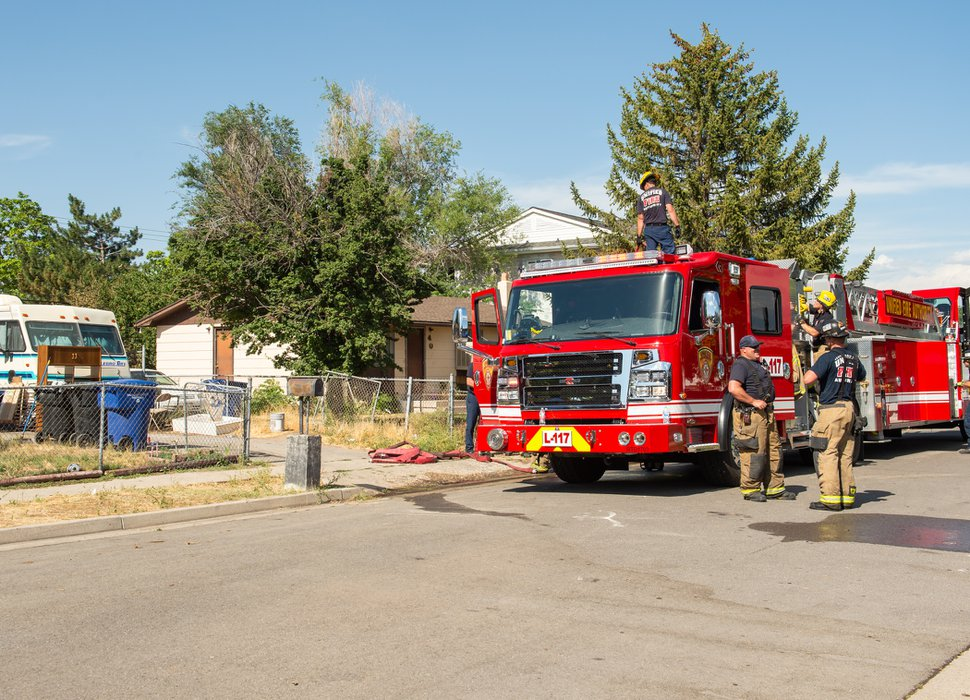 (Rachel Molenda   The Salt Lake Tribune) Firefighters finish their work at the scene of a fire at 4094 W 5820 S in Kearns, Utah, on Friday, July 6, 2018.