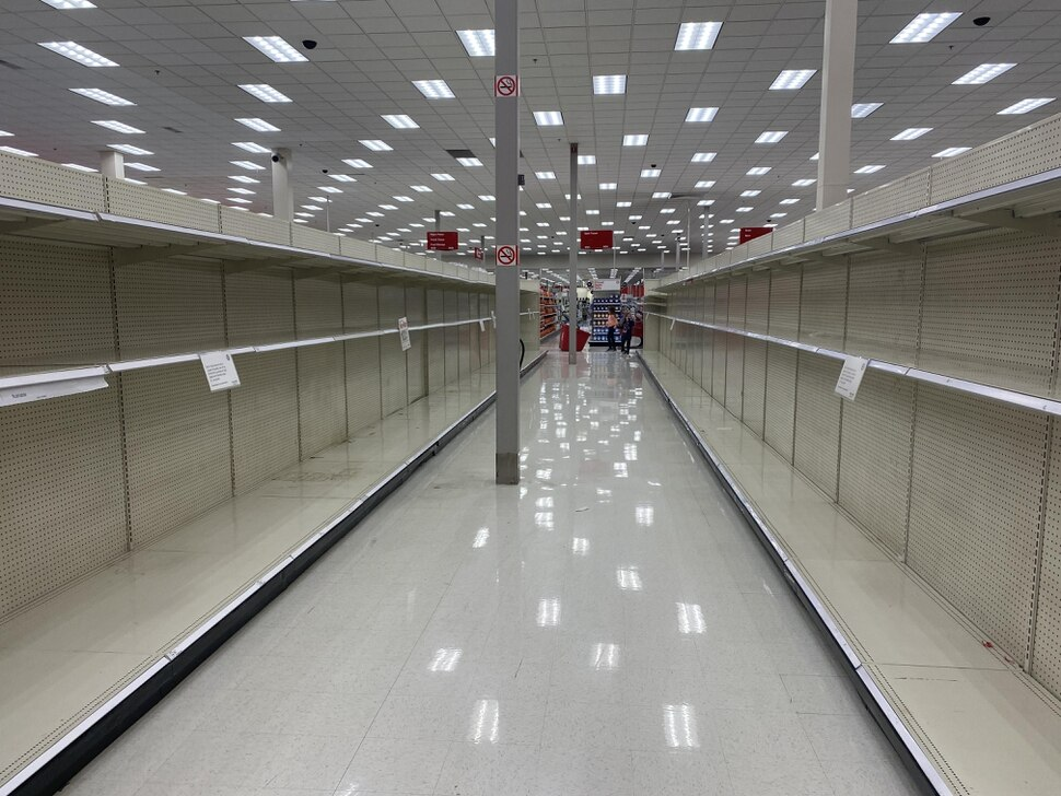 (Photo courtesy of Jordan Hanzon/J. Willard Marriott Library) Shelves that had contained paper products were emptied at a local Target.