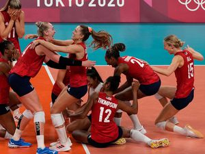 (Frank Augstein | The Associated Press) Players from the United States react after defeating Brazil to win the gold medal in women's volleyball at the 2020 Summer Olympics, Sunday, Aug. 8, 2021, in Tokyo, Japan.