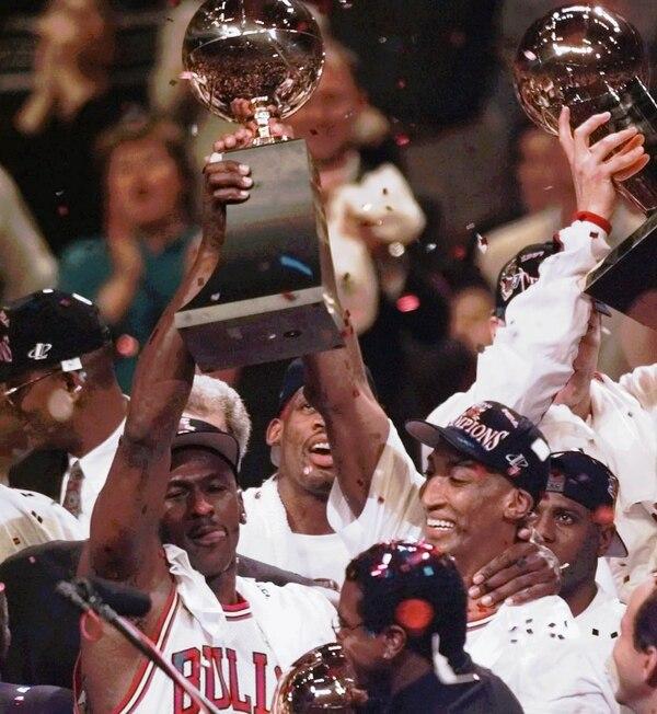 Chicago Bulls Teammates Michael Jordan Left And Scottie Pippen Hoist The Trophy Aloft After