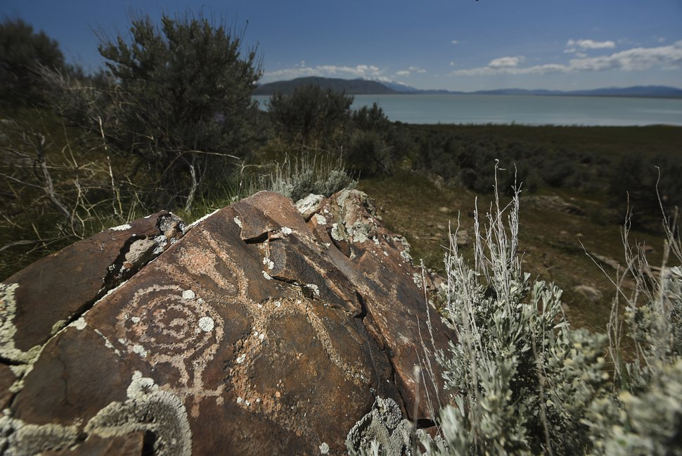 (Francisco Kjolseth | Tribune file photo) This May 3, 2019, photo shows one of many rock art panels at the Smith Preserve on the west shore of Utah Lake. Flames swept over much of the preserve on June 28 after a motorist triggered a fire on the property while allegedly trying to avoid a road closure associated with the Knolls Fire. The new fire destroyed the vehicle and sent one of its occupants to the hospital with severe burns.
