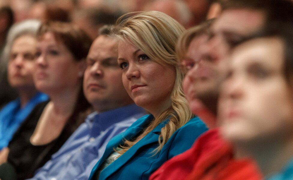 Elissa Wall attends a community meeting regarding the United Effort Plan (UEP) trust, in Colorado City, Ariz. The Utah Supreme Court is weighing a lawsuit filed by Wall who says polygamous leader Warren Jeffs forced her to marry her cousin when she was 14. Wall is asking for as much as $40 million in damages from the sect's communal property trust, which is now controlled by the state. Her testimony against Jeffs helped convict him in 2007 of being an accomplice to her rape in Utah.