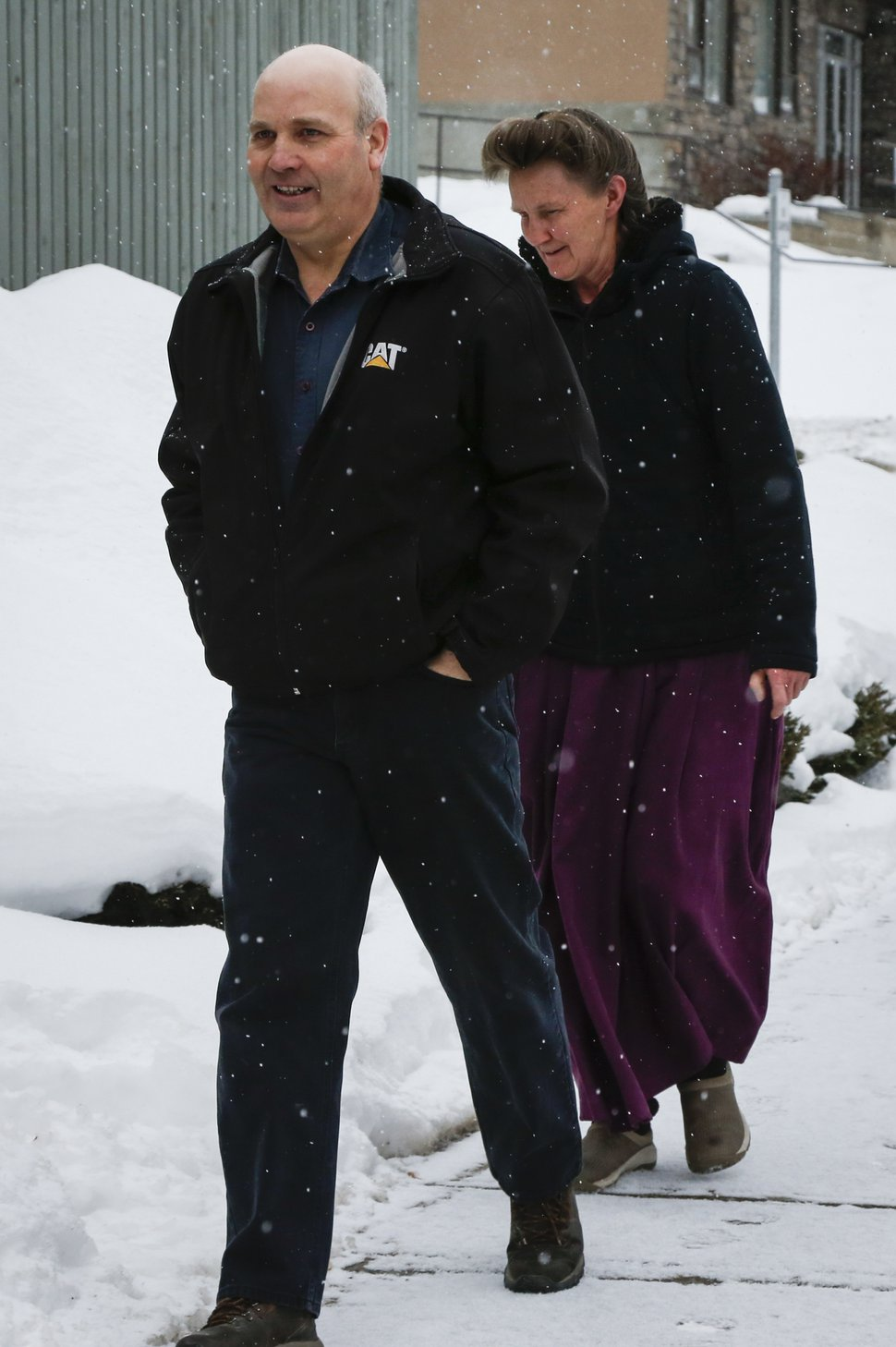 FILE - In this Feb. 3, 2017, file photo, Gail Blackmore, right, and James Oler arrive at the courthouse in Cranbrook, British Columbia. Two former bishops of an isolated religious commune in British Columbia were convicted Monday, July 24, of practicing polygamy after a decadeslong legal fight launched by the provincial government. The court found James Oler married five women in so-called