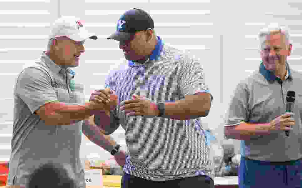 Utah's Kyle Whittingham and BYU's Kalani Sitake teamed up on the golf course Monday, but things are about to get much more serious