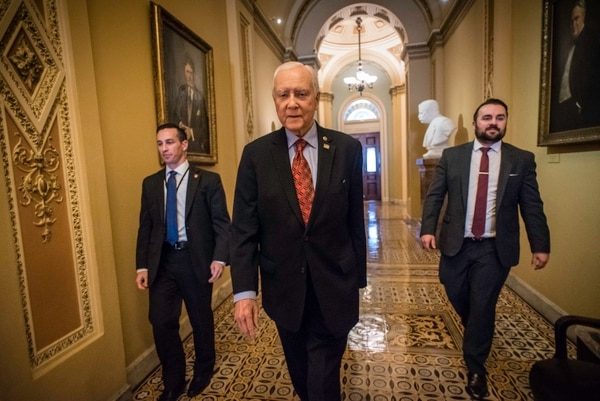 (AndrŽ Chung | special to The Salt Lake Tribune) Flanked by his security staff on the left and Matt Whitlock, his communications director on the right, Sen. Hatch makes his way to a luncheon in Washington D.C. on December 21, 2017. Senator Orrin Hatch is the senior senator from Utah, Chairman of the Senate Finance Committee and President pro tempore of the United States Senate.