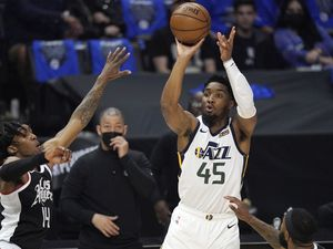 Utah Jazz guard Donovan Mitchell, right, shoots as Los Angeles Clippers guard Terance Mann defends during the first half in Game 6 of a second-round NBA basketball playoff series Friday, June 18, 2021, in Los Angeles. (AP Photo/Mark J. Terrill)