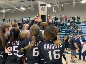 (Alex Vejar | The Salt Lake Tribune) Lone Peak players celebratye with their trophy after winning the 6A volleyball championship, holding off Copper Hills in four sets.