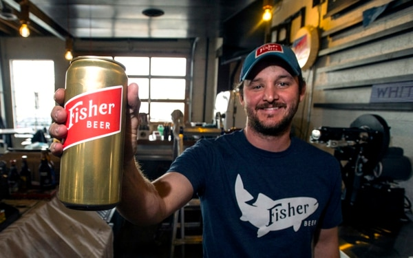 Steve Griffin | The Salt Lake Tribune Steven Brown holds a fresh can of beer at the new A. Fisher Brewing Company in Salt Lake City. The brewery, one of the oldest names in Utah beer history, made a modern-day comeback in 2017.