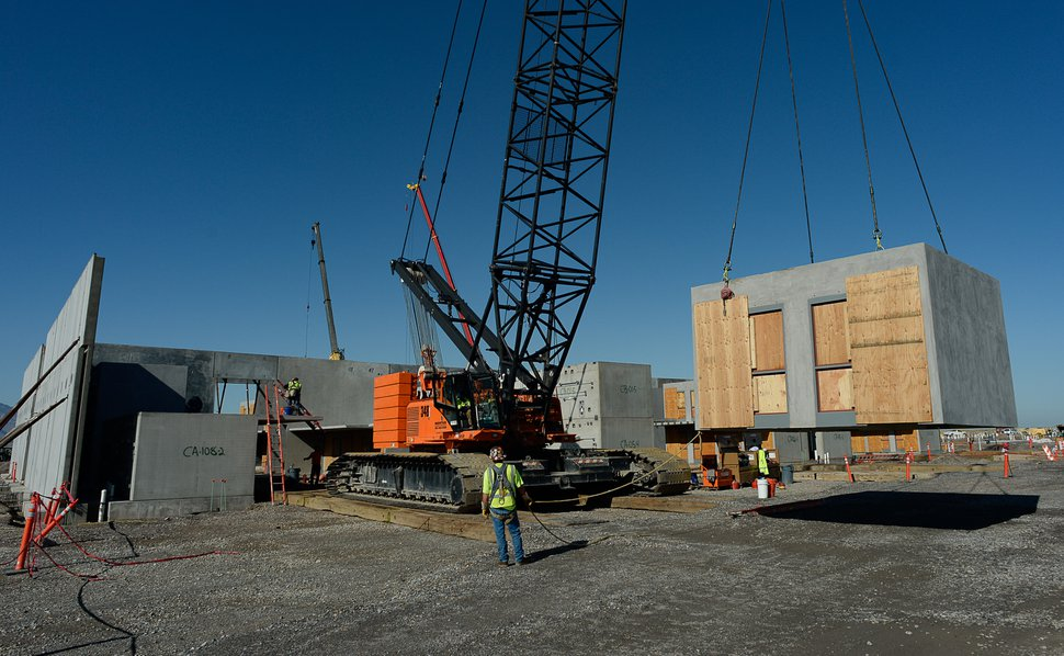 (Francisco Kjolseth | The Salt Lake Tribune) The men's max cell unit area takes shape as crews move a side by side single-occupancy cell block, stacking them into place at the new state prison in Salt Lake City on Thursday, Sept. 12, 2019.