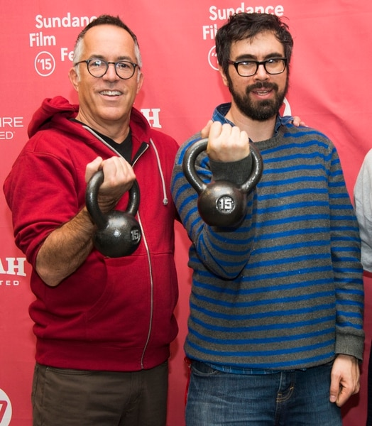 Sundance Film Festival Director John Cooper, left, and director Andrew Bujalski hold weights as they attend the Results premiere during the 2015 Sundance Film Festival on Tuesday, Jan. 27, 2015, in Park City, Utah. (Photo by Arthur Mola/Invision/AP)