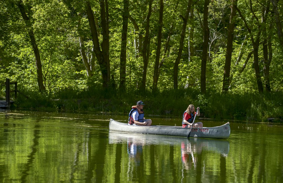 (Leah Hogsten | The Salt Lake Tribune) BSA Camp Tracy employees James Jette, 18, and Hensley Ballamis paddle around Taylor Lake, Thursday, May 24, 2018.