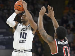 Utah State forward Alphonso Anderson (10) shoots as Fresno State guard New Williams (0) defends during the first half of an NCAA college basketball game Saturday, Dec. 7, 2019, in Logan, Utah. (AP Photo/Eli Lucero)