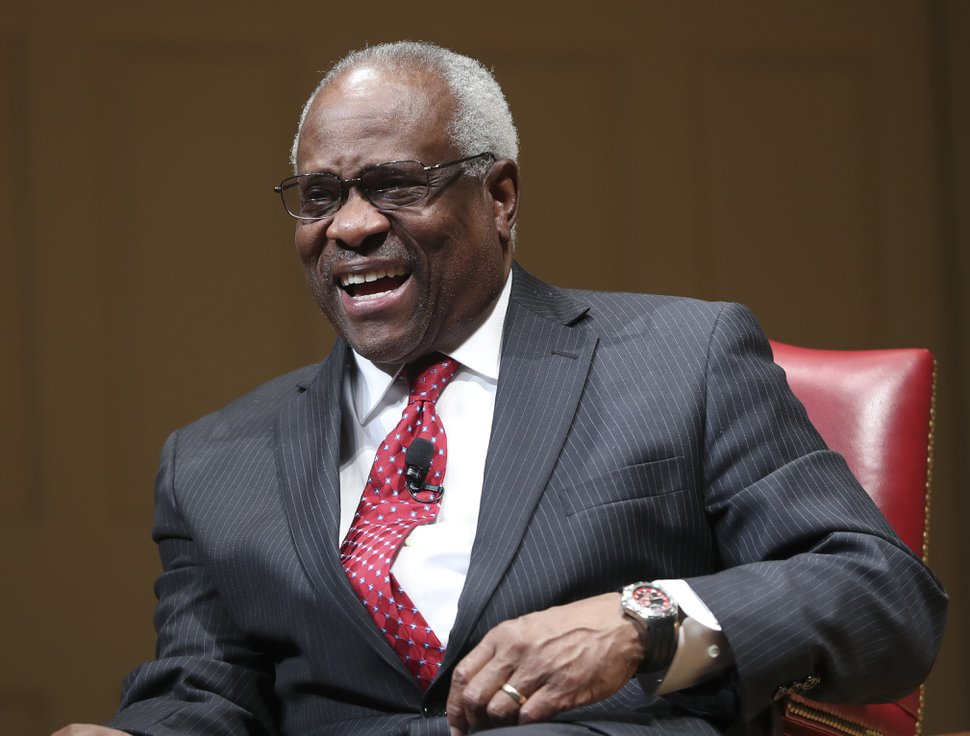 Supreme Court Associate Justice Clarence Thomas smiles as he is introduced during an event at the Library of Congress, Thursday, Feb. 15, 2018, in Washington. (AP Photo/Pablo Martinez Monsivais)