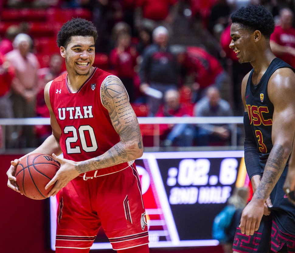 (Rick Egan | Tribune file photo) USC Trojans guard Elijah Weaver (3), jokes with Utah Utes forward Timmy Allen (20) in the final seconds of the game, in PAC-12 basketball action between Utah Utes and USC Trojans at the Jon M. Huntsman Center on Thursday, March 7, 2019.