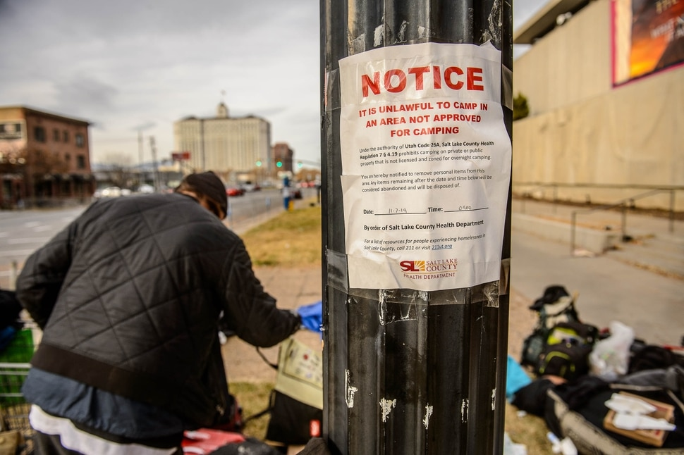 (Trent Nelson | The Salt Lake Tribune) A posted notice by the Salt Lake County Health Department prohibiting camping near the Salt Lake City Library on Tuesday, Nov. 19, 2019.