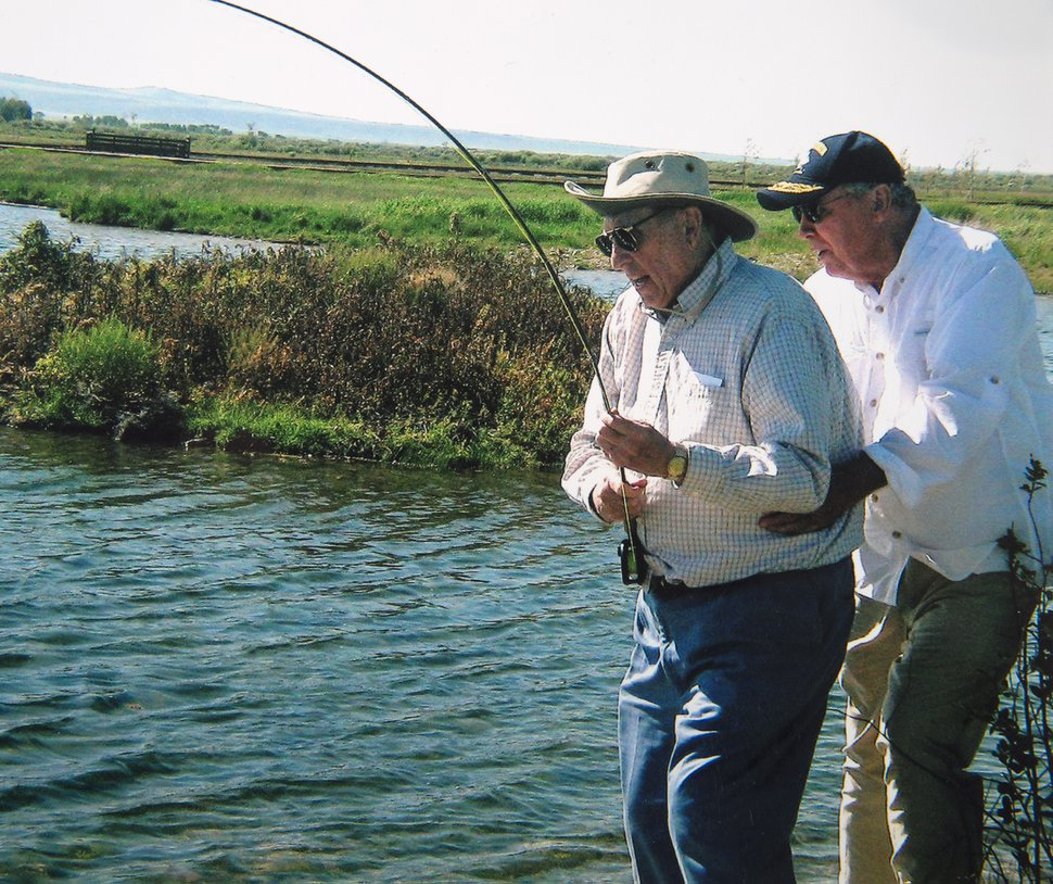 (photo courtesy Huntsman family) President Thomas S. Monson is steadied by Jon Huntsman, Sr., as he tries to a land a trout.