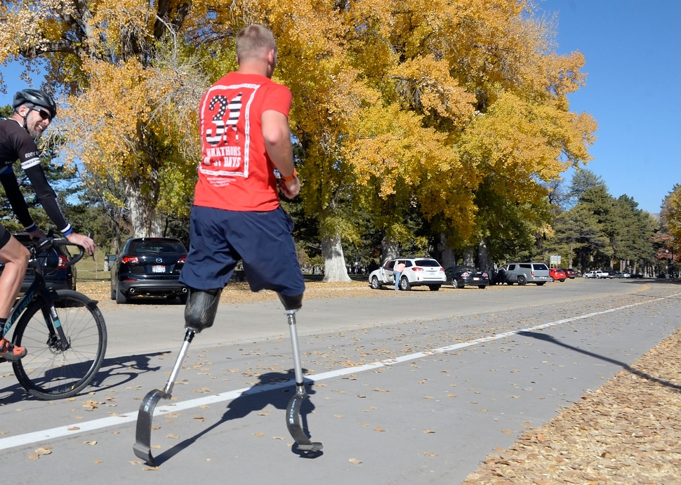 "Al Hartmann | The Salt Lake Tribune) Rob Jones, a retired Marine Corps Sergeant who lost both legs when he stepped on an improvised explosive device in Afghanistan, runs a marathon, (26.2) miles in Liberty Park in Salt Lake City Wednesday Oct. 25. He won a Bronze Medal in the Paralympics and he wis the first and only double above the knee amputee to ride a normal bicycle 5,180 miles across America. Now, he is set to run 31 marathons in 31 days in 31 major cities. Starting in London on October 12th, and continuing in the United States and Toronto, he will run 26.2 miles in the selected city on his own, travel to the next city, and repeat, ending appropriately on Veterans Day in our Nation's Capital. His motto, ""Survive. Recover. Live."""
