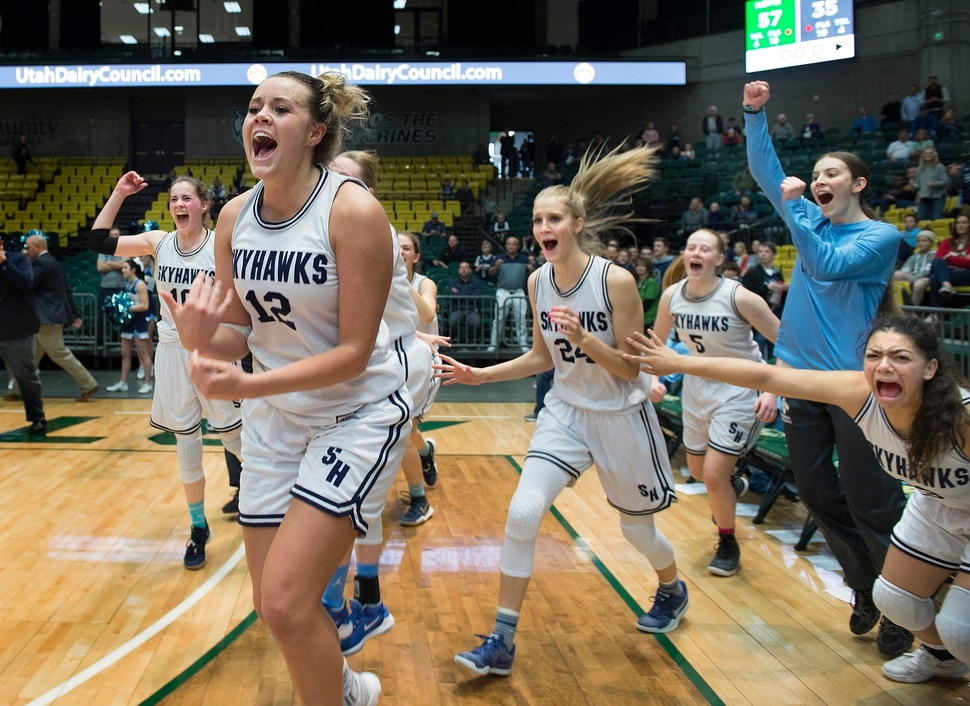 Scott Sommerdorf | The Salt Lake Tribune Salem Hills' Lauren Gustin, #12, leads her team in celebrating their 57-35 win over Hurricane for the 4A girl's title, Saturday, March 3, 2018. Gustin finished the game with 32 points and dominated in the win.