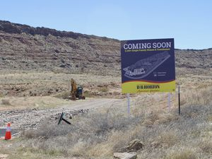 (Joan Meiners | The Spectrum via AP) In this March 28, 2021, photo, a D.R Horton's developer's sign is posted at the existing exit for Long Valley Road showing plans for a new 2,100 single family homes and townhomes subdivision along the Southern Parkway near Sand Hollow Reservoir in Washington County, Utah. Conservationists are fighting plans to extend Long Valley Road south into desert tortoise habitat to provide a second entrance to the subdivision.