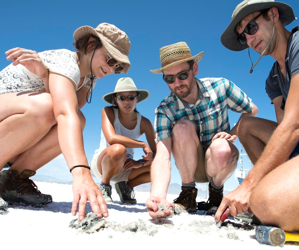 (Rick Egan | The Salt Lake Tribune) Left to right - University of Utah graduate students Emily Kam, Hannah Stimson, examine the salt crust on the Bonneville Salt Flats along with Ciaran Harman, asst. professor at John's Hopkins University, and University of Utah graduate student Jeremiah Bernau, doing research with University of Utah professor Brenda Bowen on the effects human of activity on the salt crust. Thursday, August 10, 2017.