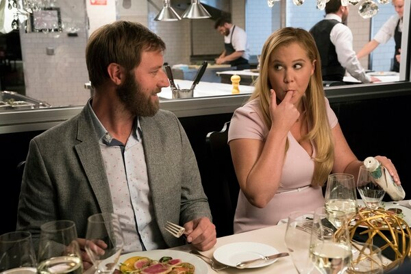 (Courtesy Mark Schäfer | STX Films) Amy Schumer, next to Rory Scovel, plays a woman who wakes up changed after a head injury.