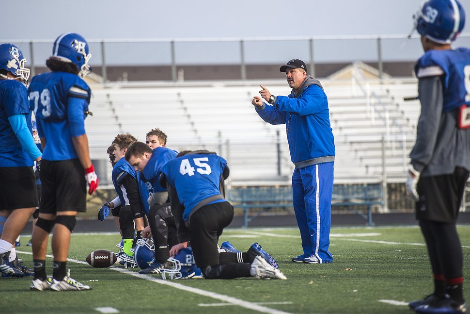 Chris Detrick | The Salt Lake Tribune Bingham High coach Dave Peck works with members of the Bingham High School football team as they practice Wednesday December 17, 2014. Bingham will compete in the State Champions Bowl Series December 27th at Florida Atlantic University.