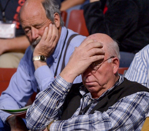 (Leah Hogsten | The Salt Lake Tribune) l-r Frustrations and weariness show on the faces of delegates as the convention drags on due to rigorous debate on bylaws, amendment proposals and rules at the Utah Republican Nominating Convention Saturday, April 21, 2018 at the Maverik Center.