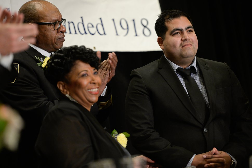 (Francisco Kjolseth | The Salt Lake Tribune) Trooper Ruben Correa of the Utah Highway Patrol is presented with a First Responder Award by Battalion Chief Jeffrey Thomas and Jeanetta Williams, President of the NAACP Salt Lake Chapter during the Dr. Martin Luther King Jr. Memorial Luncheon at Little America Hotel on Monday, Jan. 20, 2020. Trooper Correa conducted a traffic stop on Oct. 19, 2019, where he pulled an unconscious driver from a vehicle moments before it was struck by a Frontrunner train.