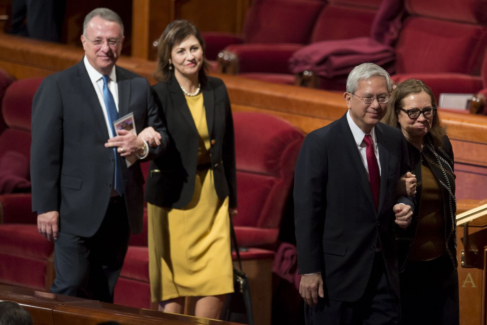 (Jeremy Harmon | The Salt Lake Tribune) Elder Ulisses Soares and Elder Gerrit W. Gong leave conference with their wives at the end of the Sunday morning session of General Conference on April 1, 2018.