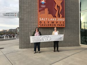 (Kim Woodbury) Kim Petersen, left, and Kim Woodbury hold a sign displaying the names of all 246 Utah cities they visited between May 2016 and October 2018. Salt Lake City was their final stop.