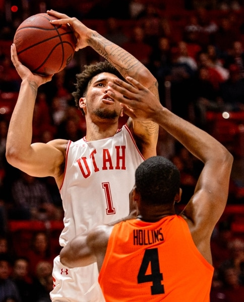 (Trent Nelson | The Salt Lake Tribune) Utah Utes forward Timmy Allen (1) shoots over Oregon State Beavers forward Alfred Hollins (4) as the University of Utah hosts Oregon State, NCAA men's basketball in Salt Lake City on Thursday, Jan. 2, 2020.
