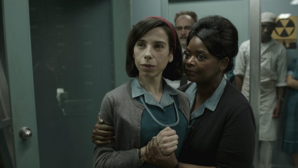 This image released by Fox Searchlight Pictures shows Sally Hawkins, left, and Octavia Spencer in a scene from the film The Shape of Water. (Fox Searchlight Pictures via AP)