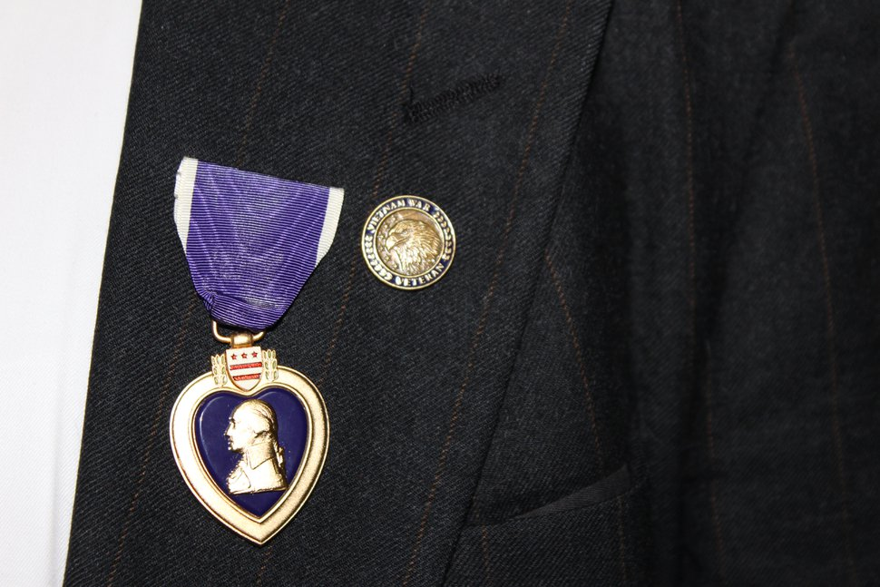 (Photo courtesy of Alyson Heyrend) A Purple Heart is pinned on Douglas W. Evans' left lapel during a ceremony July 13, 2020, at the West Jordan Offices of Rep. Ben McAdams, D-Utah. Evans received one Purple Heart while in a hospital in Vietnam in 1966, but he did not receive the certificates documenting the medal's authenticity.